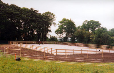 20×40m arena constructed in extremely wet conditions with no outfall facilities and finished using large soakaways with no open discharge