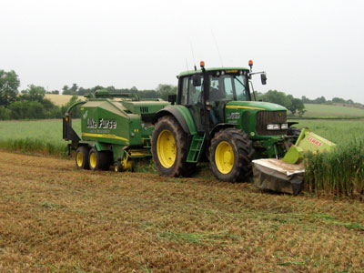 Harvesting Wholecrop Organic Winter Oats – Direct cut operation using a 10ft cut Mower Conditioner with John Deere 678 Baler Wrapper Combination