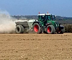 Lime being applied at the rate of 2 tonnes per acre – this field was later planted with Spring Barley